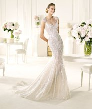 VENTURA Ventura is a magnificent beaded dress from the Manuel Mota 2013 collection for Pronovias. Its sweetheart neckline with wide shoulder straps decorated with delicate bead appliqués is made to flatter. This mermaid wedding dress shimmers with mother-of-pearl embroidery that emphasizes a wonderful figure. The semi-sheer skirt is embellished with original strips of mother-of-pearl embroidery creating a really modern silhouette.