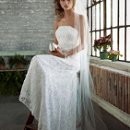 Galina Style S8551  <br /> Allover beaded lace gown with empire waist.