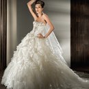 2846 Beaded Strapless, Satin Organza, Ball Gown with a lace-up back and multi-ruffled skirt with scattered feathers.
