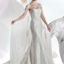 Ultra Sophisticates STYLE 1469 Beaded lace, strapless fit n flare gown with a soft scoop neckline and attached Chapel train. Lace Cape with jewelling sold separately – CA08