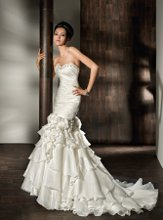 2853 Satin, Fit 'n' Flare, Strapless with a beaded Sweetheart neckline, Ruched bodice and Lace-up back. Detachable multi-tiered Skirt features a mini gown with Flowers. Long to short