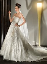 524 Beaded Strapless A-line with a Sweetheart neckline and Lace-up back. The Skirt features beaded Scroll flower motif. Attached Train