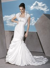 GR211 Satin, Strapless, Sheath with a A-Symmetrical ruching and jeweled medallion on Empire Waist. Trumpet Skirt features side draping, jeweled medallion and Bubble hem. Matching Bolero Jacket.