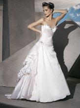 GR214 Organza Taffeta, A-line wtih a ruched wrap bodice, Lace-up back and Jeweling on neckline and waist. A-line Skirt features side bustles and draping.