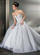 Style 521: Beaded, Sparkling Tulle, Strapless Ball Gown with a Sweetheart neckline and Basque Waist. Removable wrap-around train.