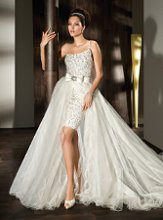 Style 526: One Shoulder, fully beaded Mini with Wrap-around tulle train featuring a bow with a Jewel encrusted broach.