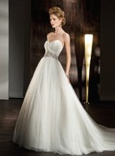 532 Soft tulle, Strapless with a full A-line skirt ruched bodice and Sweetheart neckline. Gown features a beaded, Jewel encrusted belt.