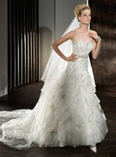 529 Beaded, Fit 'n' Flare, Strapless with a Sweetheart neckline, Lace-up back and multi-tiered, pleated Organza ruffles on skirt.