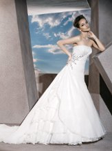 3176 Satin Organza, Strapless, A-line with a Ruched, wrap bodice and Lace-up back. Side bodice embellished with Jeweling.