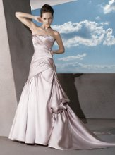 4288 Satin, Strapless, A-line with A-symmetrical pleating throughout gown. Skirt features a side bustle. Beaded belt sold separately.