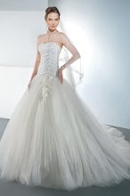 STYLE 541 Strapless gown with a soft, Sweetheart neckline and full, tulle, A-line skirt. Bodice is embellished with scrolls of intricate beading and features a zipper back. Train is attached. Available in white and ivory