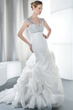 STYLE 3184 Asymmetrical Ruching, Beaded and Jeweled Empire Bodice, Keyhole and Lace-Up Back, Bustled Skirt