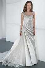 STYLE 4302 Satin Organza, Strapless with a Sweetheart neckline, ruched wrap bodice and attached jeweled belt. A-line skirt features layers of ruffles and flowers continuing throughout attached train. Available in ivory and white