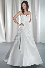 STYLE GR236 Taffeta, fit and flare with asymmetrical ruching, Sweetheart neckline and corset back. Draped skirt features a jeweled appliqué on side and attached train. Available in white, diamond white, ivory