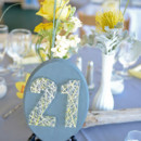 130x130 sq 1384471160662 seasideweddingtabl