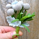 a cluster of silver brunia balls with dusty miller and a sprig of fresh lavender