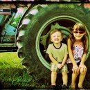 130x130 sq 1353903347403 sandyfisheronthefarmtractor