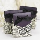 "Floral Tent Favor Boxes: These beautiful ivory tent favor boxes measure 3"" x 3¾"" x 1⅜"" and feature a delicate black floral pattern with bold contrasting eggplant flaps. Pre-cut, ⅝"" black satin ribbons are included for easy customer assembly."