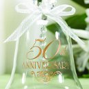 "50th Anniversary Keepsake Glass Bell: This beautiful glass 50th anniversary keepsake bell features a faceted crystal handle, a chiffon ribbon bow, and the words ""50th Anniversary"" above a pretty flourish design, all printed in gold ink. The bell measures 2¾"" x 3¾""."