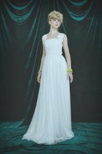 Style: 11011 VALORE Full length gown with silk tulle skirt and velvet leaves throughout bodice. Ties in back. Available in white, ivory, navy, grey and blush. 100% silk.