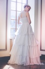Style: 11003 Back-GARDENIA Tiered ballgown of dotted swiss with illusion neckline. Keyhole at back. Available in white or ivory. 100% silk.