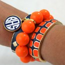 130x130_sq_1348630764889-orangenavygeckofornashmonogrambangle