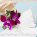 130x130_sq_1405661445958-purple-orchid-boutonniere