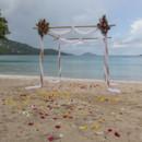 130x130_sq_1405742233072-rain-beach-wedding-4