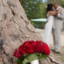 130x130_sq_1405742238428-rain-beach-wedding-6