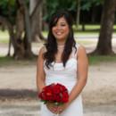 130x130_sq_1405742241270-rain-beach-wedding-7