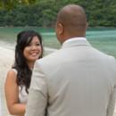 130x130_sq_1405742243399-rain-beach-wedding-8
