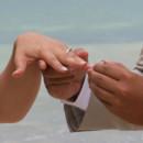 130x130_sq_1405742245467-rain-beach-wedding-9