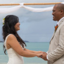 130x130_sq_1405742250029-rain-beach-wedding-11