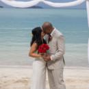 130x130_sq_1405742253477-rain-beach-wedding-12
