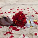 130x130_sq_1405742259238-rain-beach-wedding-14