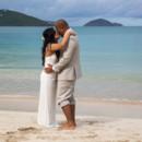 130x130_sq_1405742261636-rain-beach-wedding-15