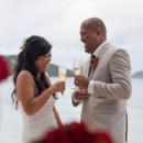 130x130_sq_1405742265816-rain-beach-wedding-17