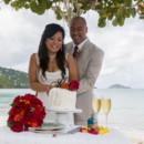 130x130_sq_1405742268276-rain-beach-wedding-18