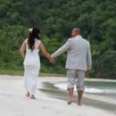 130x130_sq_1405742274728-rain-beach-wedding-21