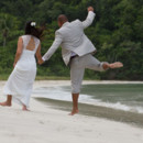 130x130_sq_1405742276811-rain-beach-wedding-22