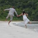130x130_sq_1405742279181-rain-beach-wedding-23