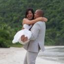 130x130_sq_1405742283701-rain-beach-wedding-25