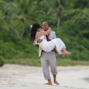 130x130_sq_1405742285713-rain-beach-wedding-26