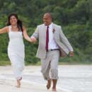 130x130_sq_1405742292324-rain-beach-wedding-29