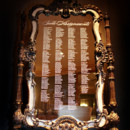 A seating chart etched on an antique mirror? Totally glam!
