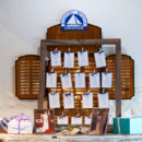Clothespins and blue ribbon help create this nautical-themed seating chart.