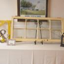 A rustic window seating chart display