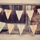 Write seating assignments on fabric bunting for a whimsical seating chart!