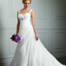 Aariana 9105 Romantic Satin Organza gown has a side draped chapel train. The draped sweetheart neckline is further defined by the elegant beading under the bodice. The contoured shoulder straps are removable. Available with a zipper or lace-up back.