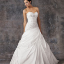 Aariana 9373 Shown in Diamond White…Heavily beaded strapless asymmetric bodice with sweetheart neckline. Tufted taffeta skirt with rosette details. Chapel train and buttons and loops on center back. Removable spaghetti straps included. Available with a lace-up or zipper back.